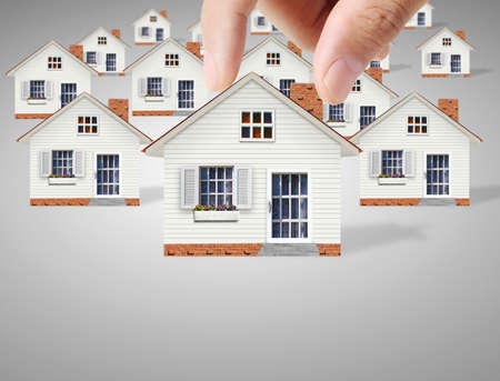 property: property insurance concept , man protect model of the house Stock Photo