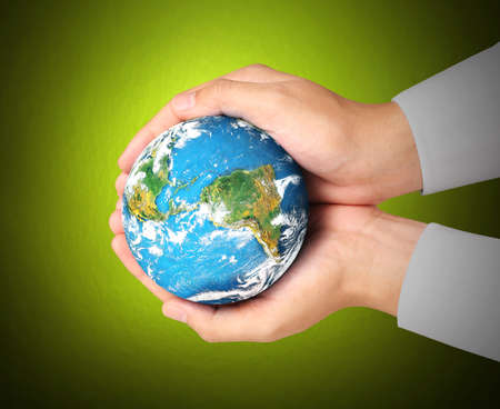 Man holding global in hands photo