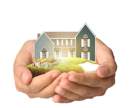 representing: Holding house representing home ownership and the Real Estate business Stock Photo