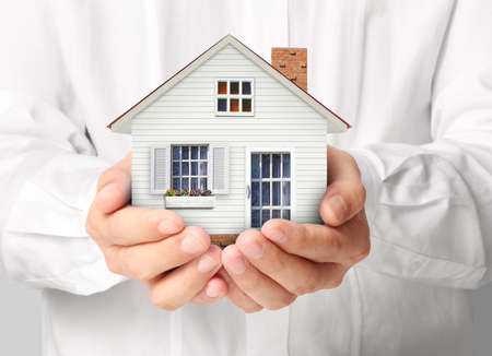 home insurance: holding house representing home ownership and the Real Estate business Stock Photo