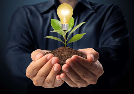 energy symbol: Energy saving light bulb, Creative light bulb idea in the hand