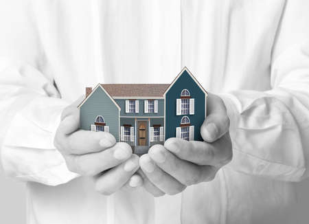 hand holding house representing home ownership Stock Photo