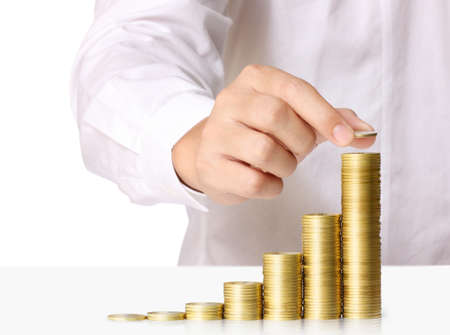 pile of coins: Human Hand human hand putting coin to money, business ideas Stock Photo