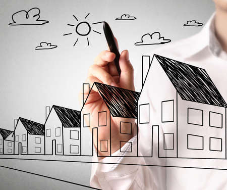 evaluating: Man drawing a growing real estate chart