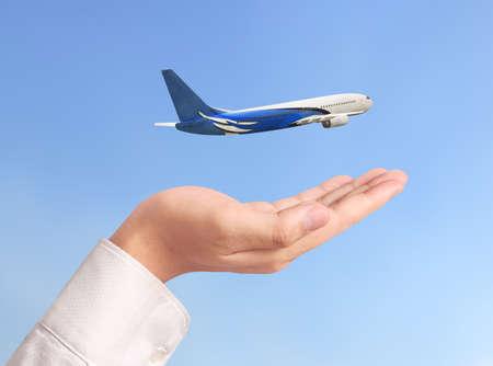 Closeup hand holding an airplane model