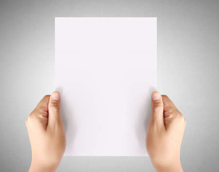 a4: holding white a blank A4 paper Stock Photo