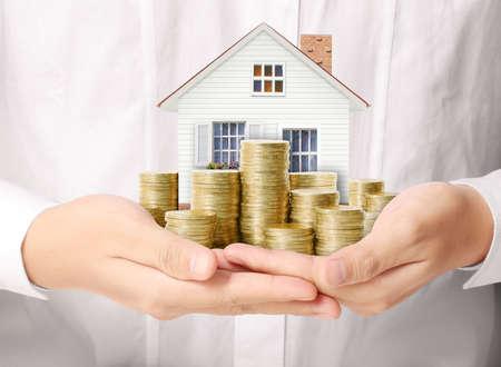 argent: notion d'hypoth�que par l'argent maison des pi�ces de monnaie