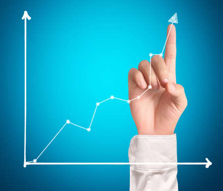 businessman Touching graph of work photo