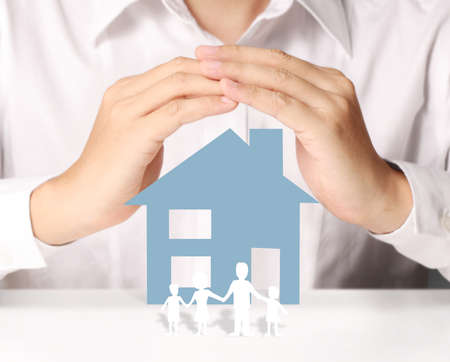 home ownership: holding house representing home ownership and the Real Estate business Stock Photo