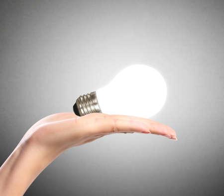 creative idea: Energy saving light bulb, Creative light bulb idea in the hand