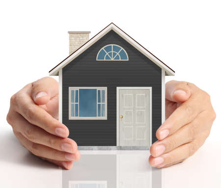 busines: holding house representing home ownership and the Real Estate busines Stock Photo
