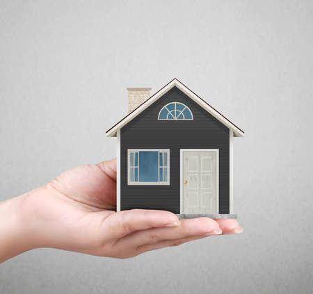 zakelijk: houden huis vertegenwoordigt eigenwoningbezit en de Real Estate bedrijf Stockfoto