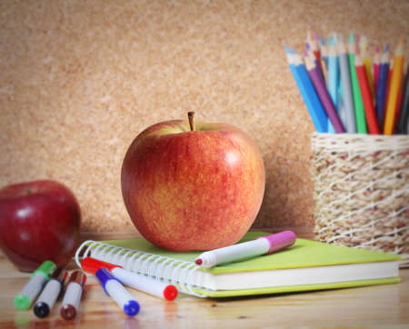teaching crayons: School supplies and a apple. Stock Photo