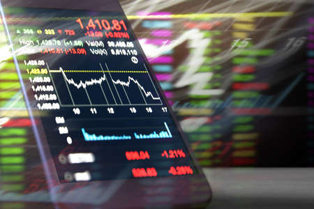 trading board: using smartphone Stock market data Stock Photo