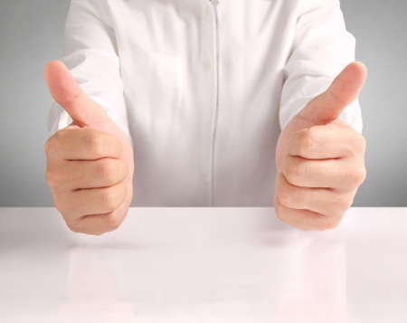 thumbs up sign: Closeup of male hand showing thumbs up sign Stock Photo