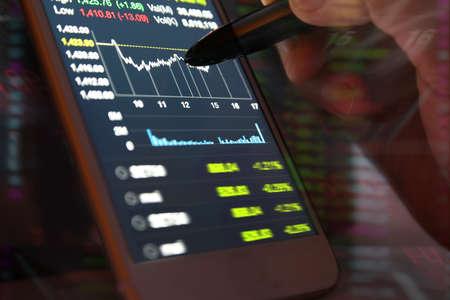 stock: using smartphone Stock market data Stock Photo