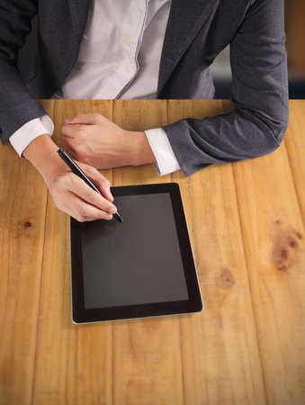 book reviews: hands holding and pointing on contemporary digital tablet
