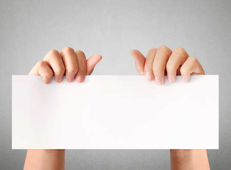 Hand holding white empty a paper Stock Photo