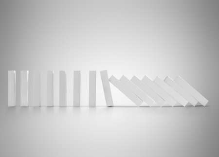 toppled: dominoes continuous toppled  effect concept for business solution