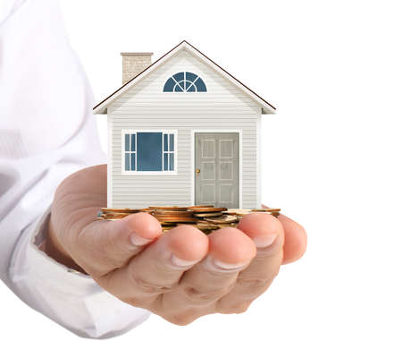 holding house representing home ownership and the Real Estate business Stock Photo