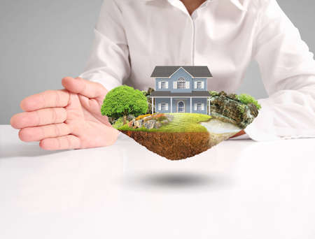 Mortgage concept by house from in hand Stock Photo