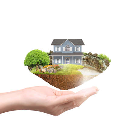 Mortgage concept by money house in hand
