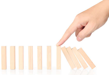 hand stop a wood block continuous toppled Stock Photo