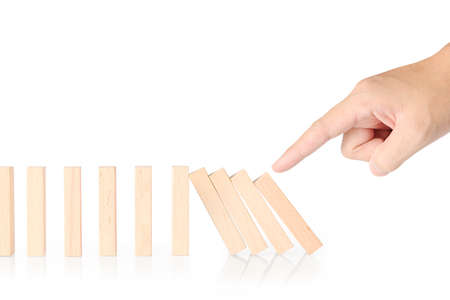 intervene: stop a dominoes continuous toppled Stock Photo