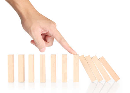 to interfere: stop a dominoes continuous toppled Stock Photo