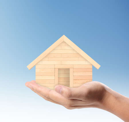 Mortgage concept by house from in a hand Stock Photo