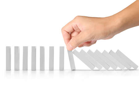 stop a dominoes continuous toppled Stock Photo