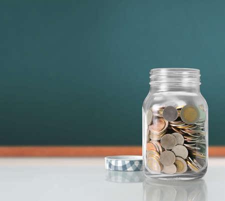 silver coins: Silver coins in a piggy bank Glass