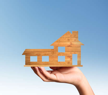 expensive: Mortgage concept by house from in a hand Stock Photo