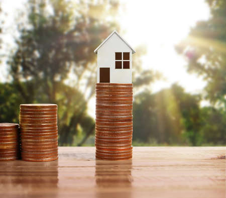 residential construction: model of the house on a Coin Stock Photo