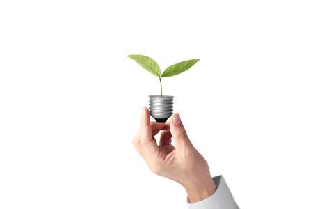 hand holding a light bulb with energy