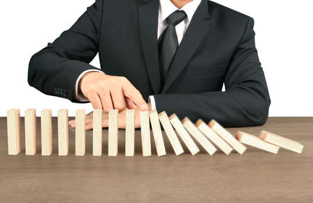 Hand Stopping domino concept , business solution