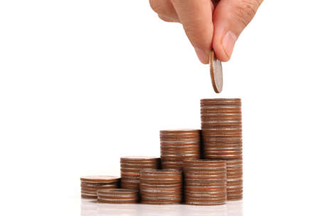 Money coin stack growing business in hand,Saving money concept