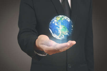 Hand holding digital icon of planet a earth