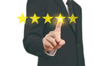 Hand touching five star symbol to increase rating of company concept