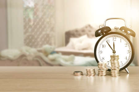 Alarm clock and step of coins stacks on , time for savings money concept, banking and business idea Stok Fotoğraf