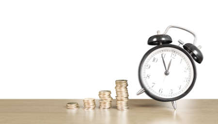 Alarm clock and step of coins stacks on , time for savings money concept, banking and business idea Stok Fotoğraf - 129810253