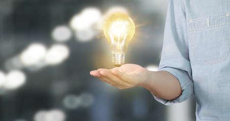 Hand of holding illuminated light bulb, idea, innovation inspiration concept
