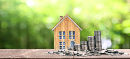 Growing coins house on stack coins. Concept of Investment propert and finance investment concep