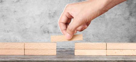 Hand arranging wood block . Business concept growth success
