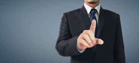 Business portrait of handsome man in black suit.Touch screen Reklamní fotografie