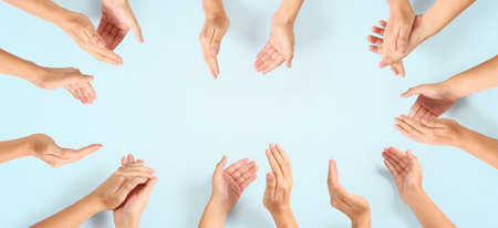 Group of hands applauding up Top view. isolated with clipping path Standard-Bild