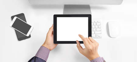 Hands holding a tablet touch computer gadget with isolated screen Banco de Imagens