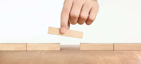 Hand arranging wood block and Business concept growth success