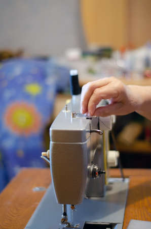 working with a black cloth on a Soviet sewing machine with black threads