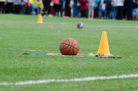 basketball and tennis ball near the orange cone in the stadium Archivio Fotografico